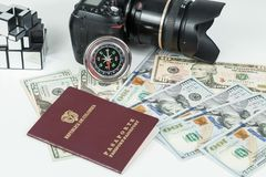 Travel concept, Colombian passport with dollar bills for travel abroad. In neutral background stock photo