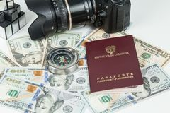 Travel concept, Colombian passport with dollar bills for travel abroad. In neutral background royalty free stock photography