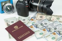 Travel concept, Colombian passport with dollar bills for travel abroad. In neutral background stock images