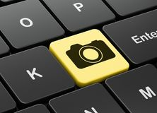 Travel concept: Photo Camera on computer keyboard background. Travel concept: computer keyboard with Photo Camera icon on enter button background, 3D rendering Royalty Free Stock Photo