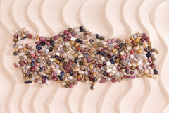 Travel concept with a creative Turkish map. Formed of colorful water worn agate and quartzite pebbles on decorative golden beach sand with a rippling wavy royalty free stock images