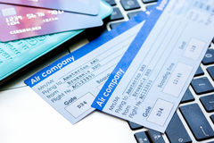 Travel concept with credit cards and flight tickets on laptop. Travel concept with credit cards, copybook and flight tickets on laptop keyboard background Stock Photos