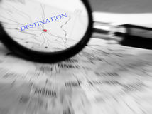Travel concept with destination in focus. A generic map with the word destination marked next to a red dot representing a major city or place.  Concept image for Stock Photo
