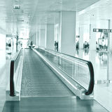 Travel concept. Escalator inside modern airport terminal Royalty Free Stock Photography