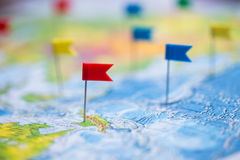 Travel concept with flag pushpins and world map.  Stock Photos