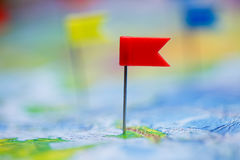 Travel concept with flag pushpins and world map Royalty Free Stock Photos