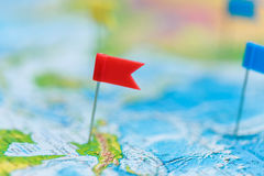 Travel concept with flag pushpins and world map Stock Image