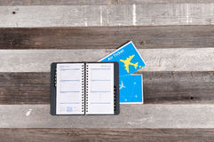Travel concept, flight tickets and notebook on wood table. Travel concept, flight tickets and notebook Royalty Free Stock Photography