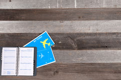 Travel concept, flight tickets and notebook. On wood table Stock Image