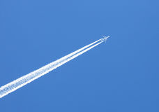 Travel concept. flying in the blue sky plane Stock Images
