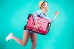 Travel concept. Full length studio portrait of beautiful tourist running with luggage. Rush to visit relatives. woman is trying to catch the train royalty free stock photos
