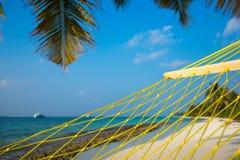 Travel concept with a hammock in a tropical beach Stock Photos