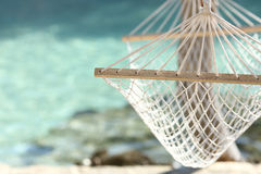 Travel concept with a hammock in a tropical beach. With turquoise water in the background Royalty Free Stock Images
