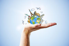 Travel concept with hand and drawn earth planet with landmarks Stock Images