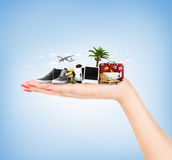 Travel concept. Hand holding atribute of travel and holiday. On a blue background stock photos