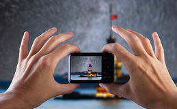 Travel concept. Hand making photo of city with camera. Istanbul. Turkey. Royalty Free Stock Photography