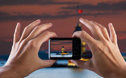 Travel concept. Hand making photo of city with camera. Istanbul. Turkey. Royalty Free Stock Images