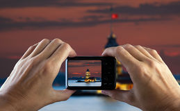 Travel concept. Hand making photo of city with camera. Istanbul. Turkey. Royalty Free Stock Image