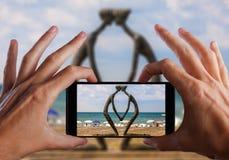 Travel concept. Hand making photo of city with smartphone camera. BATUMI, ADJARA, GEORGIA Stock Photo