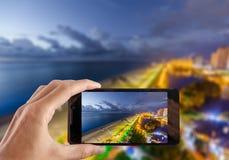 Travel concept. Hand making photo of city with smartphone camera. BATUMI, ADJARA, GEORGIA Royalty Free Stock Image