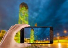 Travel concept. Hand making photo of city with smartphone camera. BATUMI, ADJARA, GEORGIA Royalty Free Stock Photo
