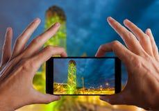 Travel concept. Hand making photo of city with smartphone camera. BATUMI, ADJARA, GEORGIA Stock Images