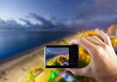 Travel concept. Hand making photo of city with smartphone camera. BATUMI, ADJARA, GEORGIA Royalty Free Stock Images
