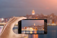 Travel concept. Hand making photo of city with smartphone camera. Istanbul. Turkey Royalty Free Stock Photo