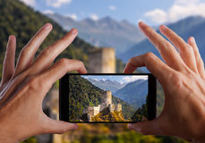 Travel concept. Hand making photo of city with smartphone camera. Istanbul. Turkey Stock Photos