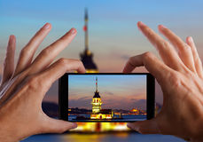 Travel concept. Hand making photo of city with smartphone camera. Istanbul. Turkey Stock Photography
