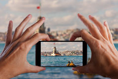 Travel concept. Hand making photo of city with smartphone camera. Istanbul. Turkey Stock Images