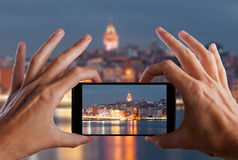 Travel concept. Hand making photo of city with smartphone camera. Istanbul. Turkey Royalty Free Stock Photography