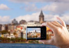 Travel concept. Hand making photo of city with smartphone camera. Istanbul. Turkey Royalty Free Stock Image