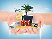 Travel concept. Hands holding iceland with palm, suitcase, photo Stock Images