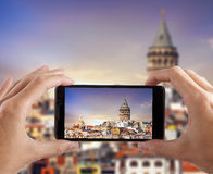 Travel concept. Hands making photo of city with smartphone camera. Istanbul. Turkey Royalty Free Stock Photos