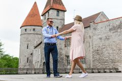Travel concept - happy tourists walking in old town. Travel concept - couple of happy tourists walking in old town Royalty Free Stock Image
