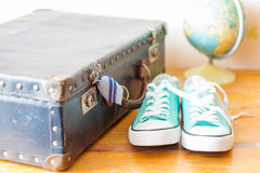 Travel concept with holiday suitcase, shoes and globe Royalty Free Stock Image