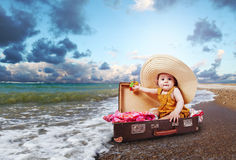 Travel concept image with baby in suitcase Stock Photos