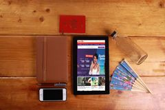 Travel and concept isolated in wooden background. SHAH ALAM , 7 OCTOBER 2016. Travel and concept background with a digital tablet show Malindo travel agency Stock Photos