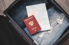 Travel concept. Jeans, card and Russian federation passport In the suitcase Selective focus.  royalty free stock images