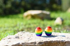 Travel concept for lgbt couple.Two eggs with LGBT flag pattern. stock images