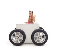 Travel concept with little girl and wheeled box Royalty Free Stock Images