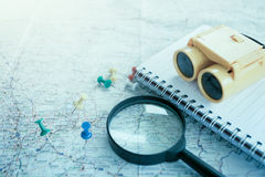 Travel concept with Magnifying glass, pushpins on map. In vintage color tone Royalty Free Stock Photo