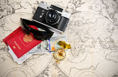 Travel concept. Main travel items for journey over mediavel world map Royalty Free Stock Photo