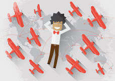 Travel concept. Man lie on the world map surrounded by red airplane and dream about travel Royalty Free Stock Photography