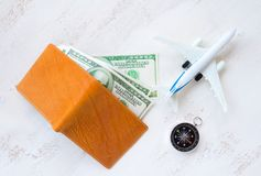 travel concept. money for travel in leather wallet with compass Stock Image