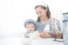 Travel concept. Mother and her baby boy with seashell. Stock Photos