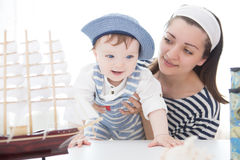 Travel concept. Mother and son playing with the ship. Two sailors mom and boy. Adventures and travel concept Stock Photo