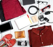 Travel concept - notepad, tablet pc, clothes, headphones, camera stock photo