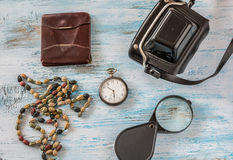 Travel concept with old camera,wallet pocket watch and magnifyin. G glass on wooden background Stock Photo